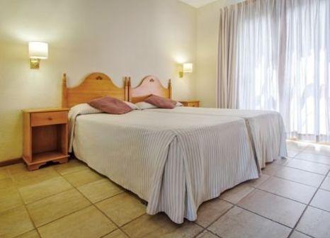 Hotelzimmer mit Mountainbike im HG Cristian Sur