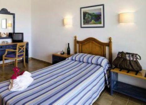 Hotelzimmer mit Mountainbike im Club Can Bossa