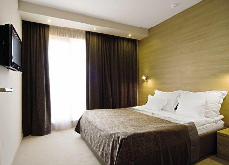 Hotelzimmer mit Mountainbike im Hotel Olympia