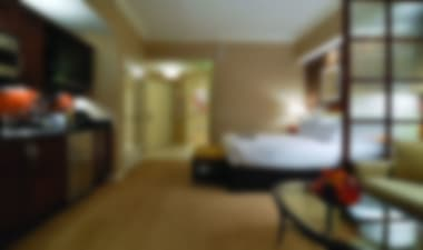 Hotel Relaxing all suite condo style property tucked next to sister mega resort includes kitchens with high end appliances