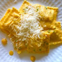 Ravioli di Zucca a la Parmigiana E Scaglie di Noci