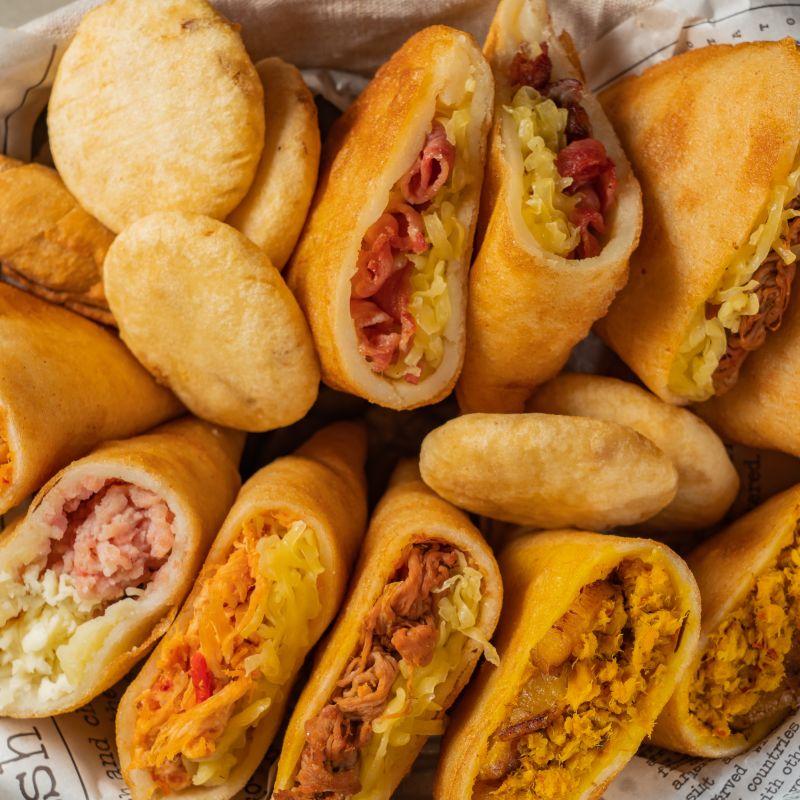Menú para 4: ración de tequeños de queso y ración de maíz con 4 Zulias