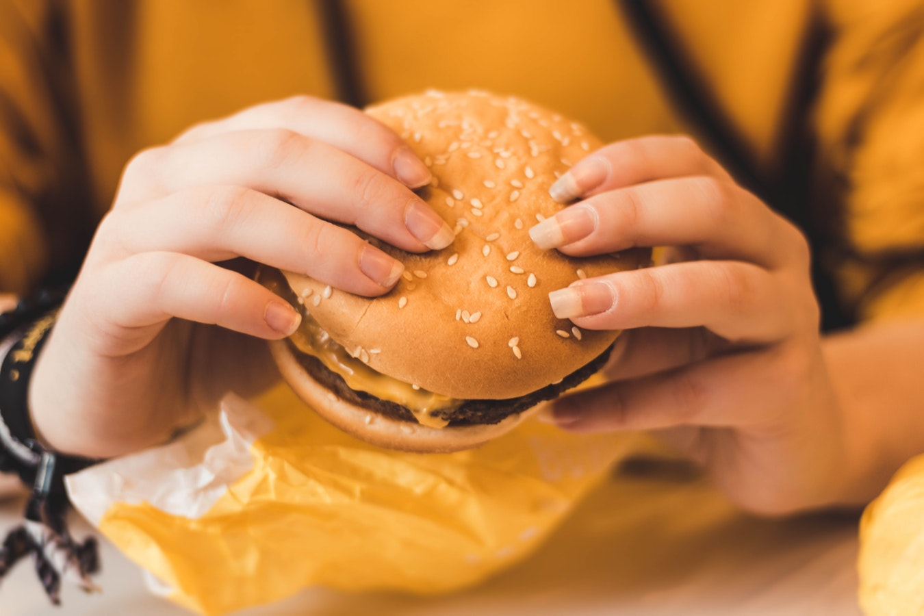 girl holding burger