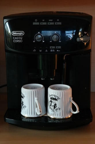 DeLonghi coffee maker with two mugs laying upside down - could be used for the internet of things