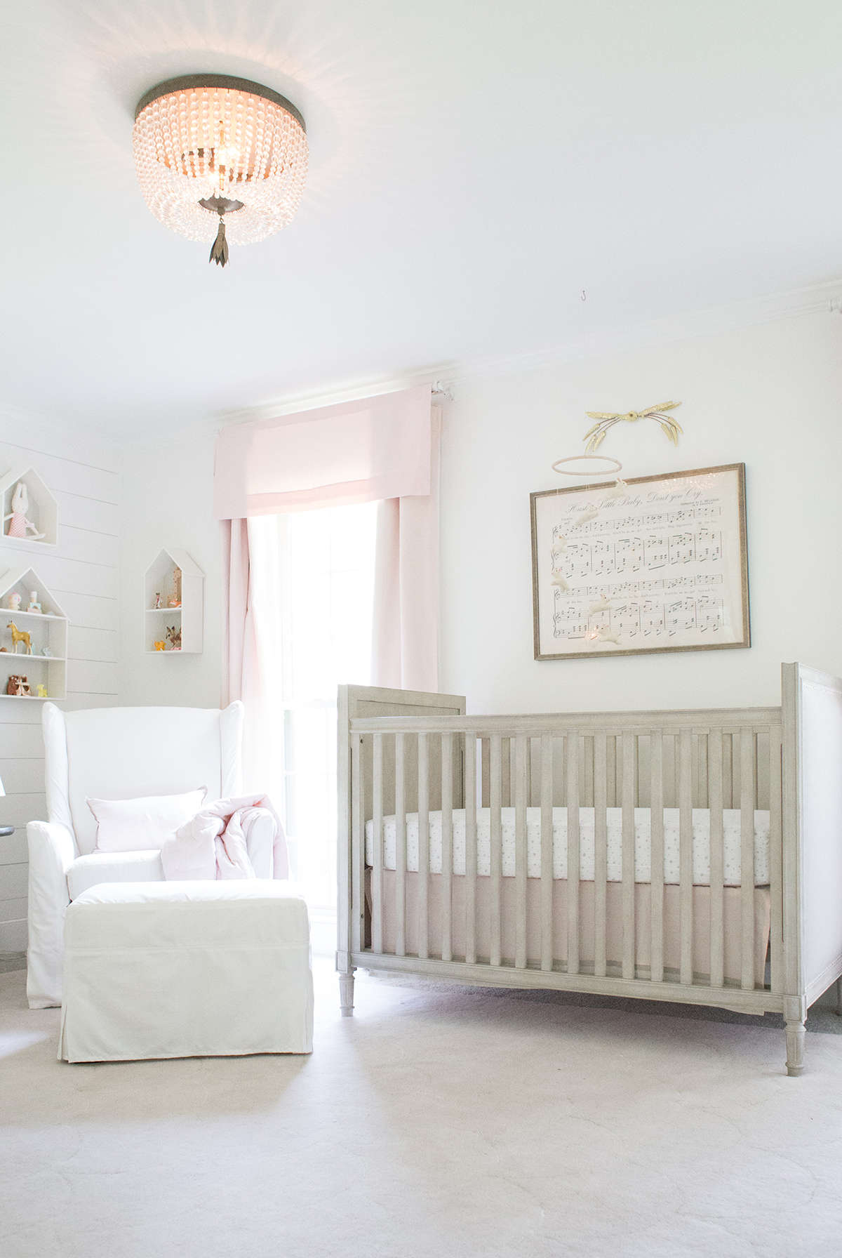 pastel pink baby nursery with shiplap