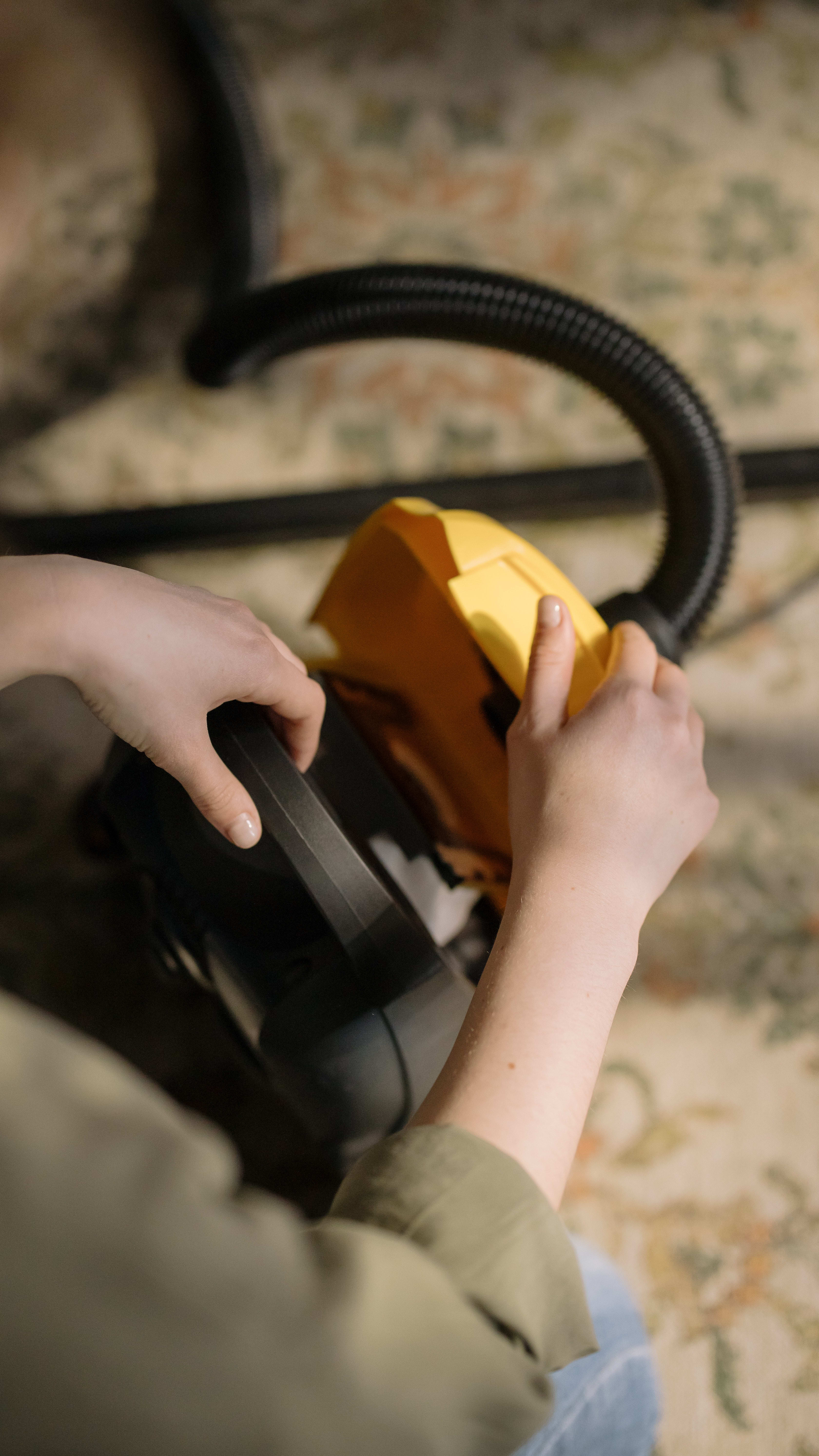Start by opening your vacuum cleaner