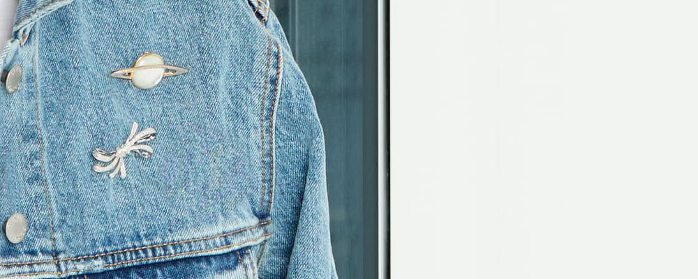Pretty pins styles to elevate your look. Model Wearing Denim Jacket With Pins
