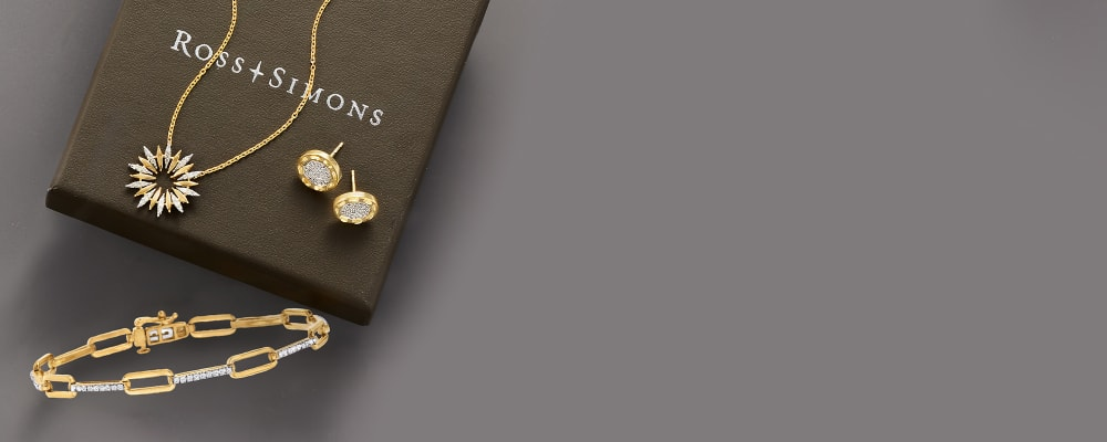 Perfect presents gifts they're sure to love. Image Featuring Assorted Jewelry Present On A Gift Box