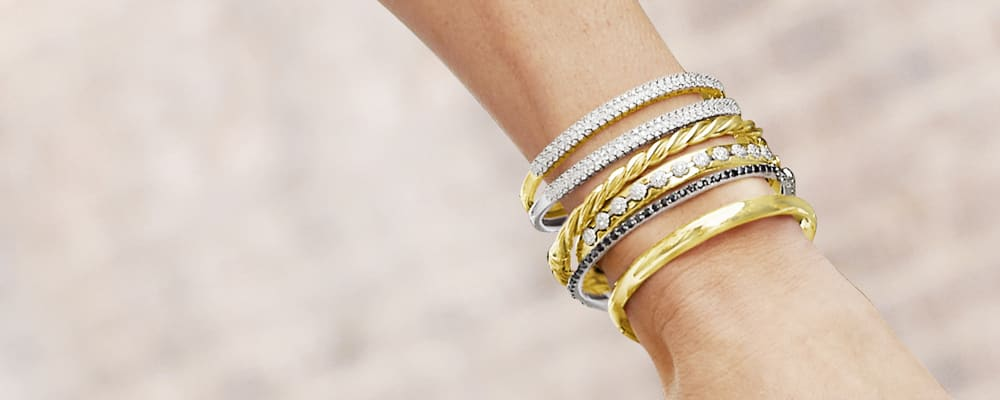Classics. Timeless Fashions For Every Day. Image Featuring A Model Wearing Gold Bracelets