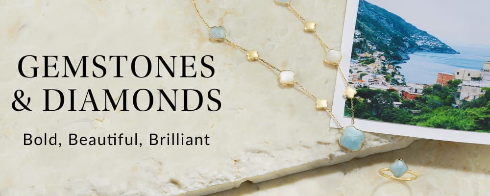 Gemstones and Diamonds. Bold, Beautiful, Brilliant. Image Featuring Gemstone Necklace & Ring on White Marble Background With a Picture of Italy