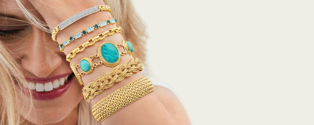 bracelets fabulous arm candy. Image Featuring Model Wearing Several Bracelets