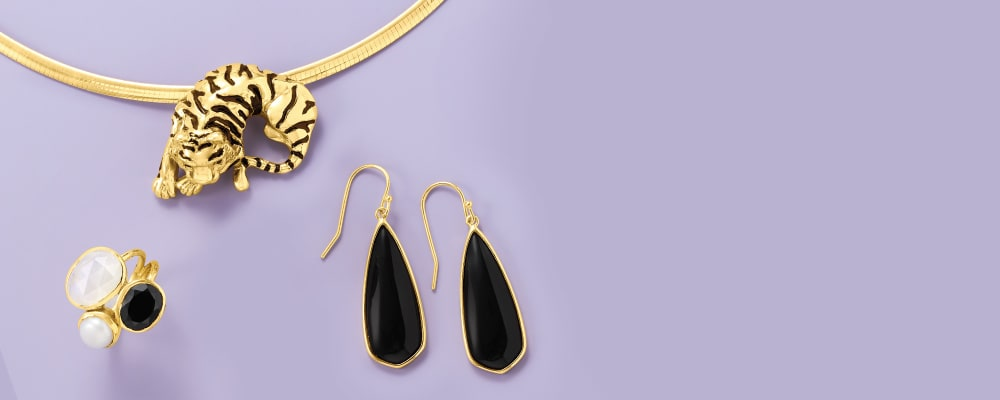 Gold Over Sterling. Image Featuring Gold Over Sterling Silver Jewelry on Purple Background