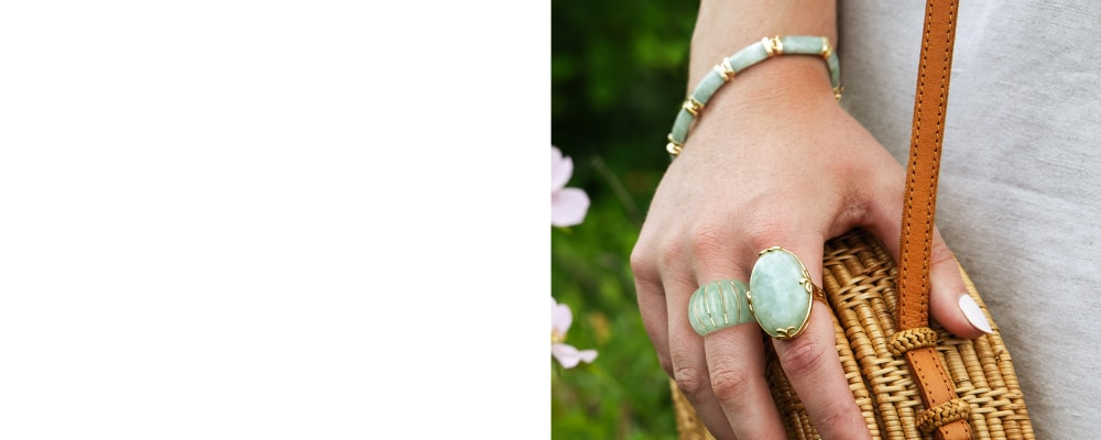 Jade symbolic of integrity and grace. Image Featuring Model Wearing two Jade Gemstone Rings
