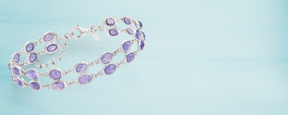 Exotic Gemstones. Rare, Unique and Colorful. Image Featuring Gemstone Bracelet on Light Blue Background
