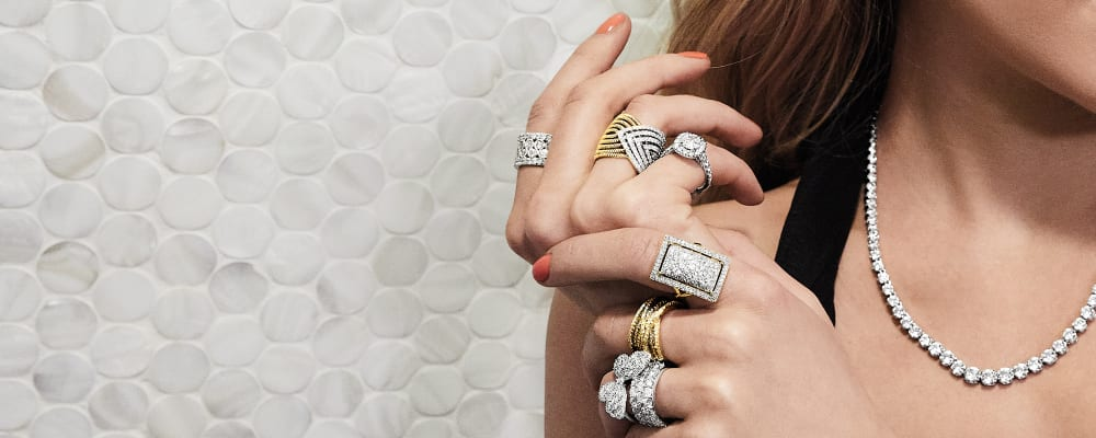 Diamond Rings. Image Featuring Model's Hand wearing diamond rings