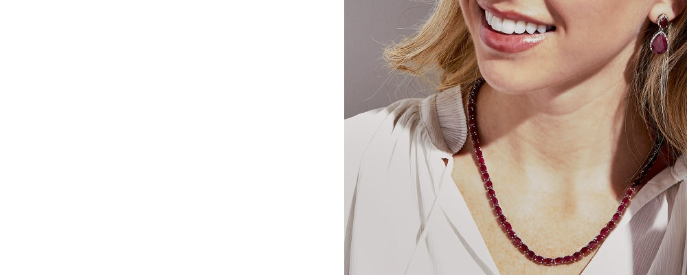 Rubies. Vibrant And Rich in Meaning. Image featuring Model Wearing A Ruby Gemstone Necklace