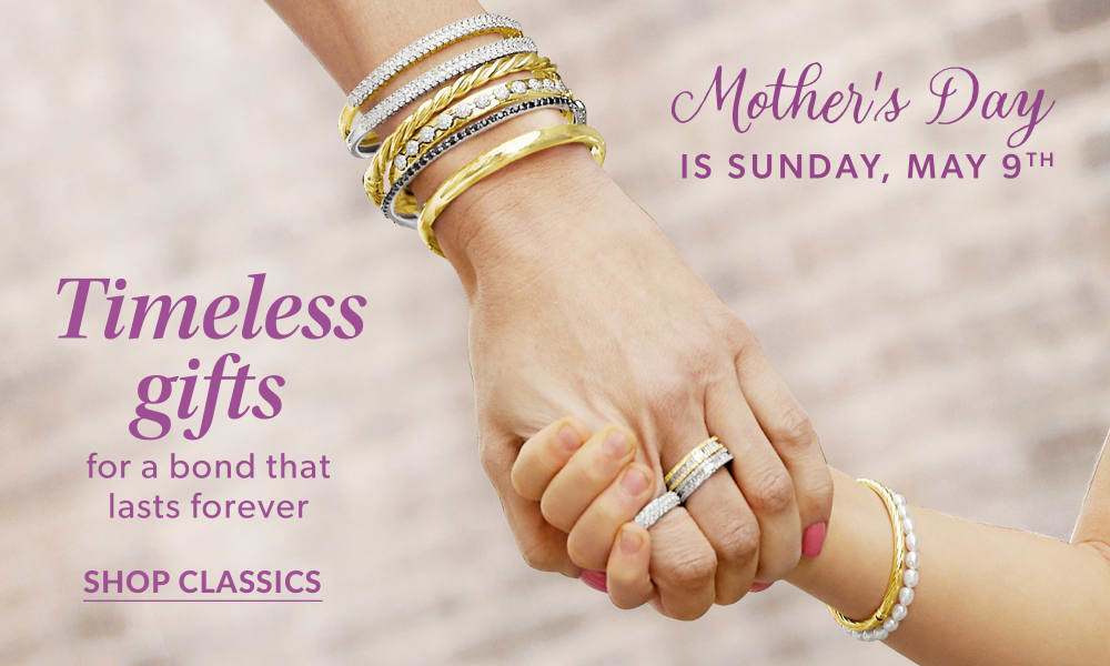 Mother's Day is Sunday, May 9th. Timeless gifts for a bond that lasts forever. Shop Classics. Image of mom holding child's hand, wearing bracelets and rings.