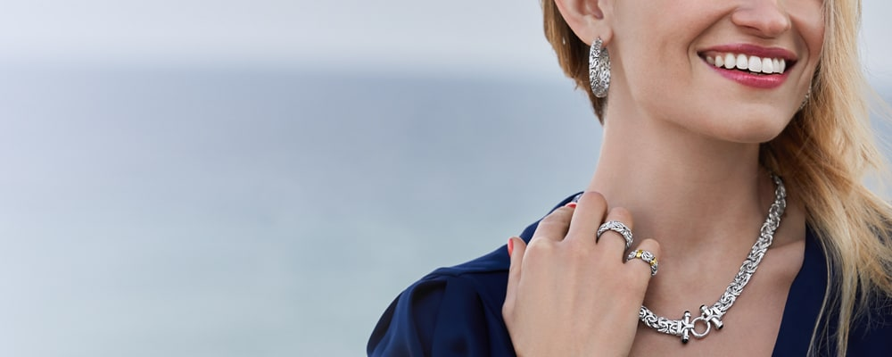 Sterling Silver. Alluring Styles For Every Budget. Image Featuring a Model Wearing Assorted Byzantine Jewelry