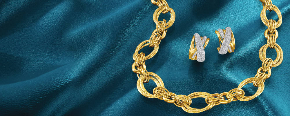Beautiful Jewelry. Irresistible Styles, Incredible Deals. Image Featuring Gold Jewelry on Blue Background