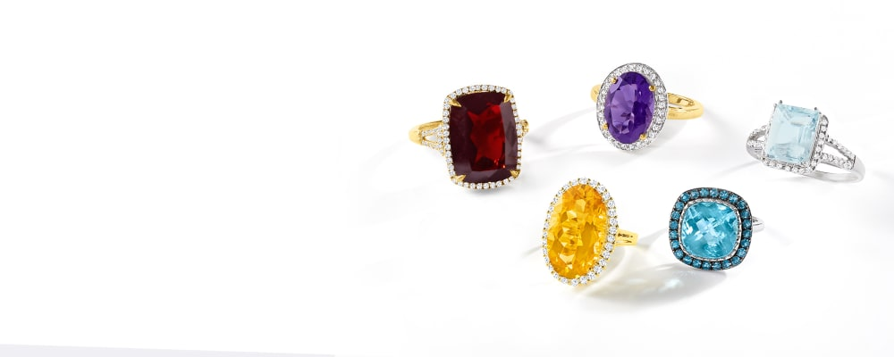 Fabulous Rings. Collect Every Chic Style. Image Featuring Gemstone Rings on a Model's Hand