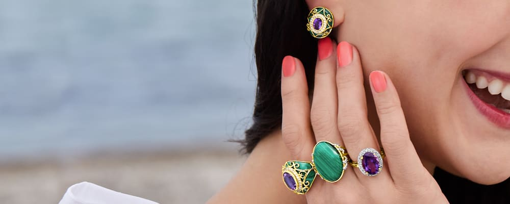 Stunning Jewelry. Fabulous Finds At Affordable Prices. Image Featuring Model Wearing Gemstone Earrings and Rings