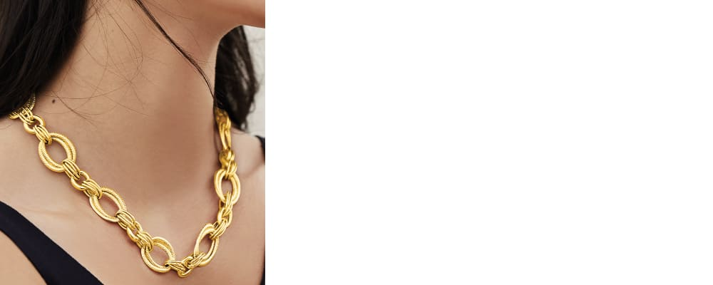 Gold Necklaces. Indulge in Gleaming Designs. Image Featuring Model wearing a gold Necklace