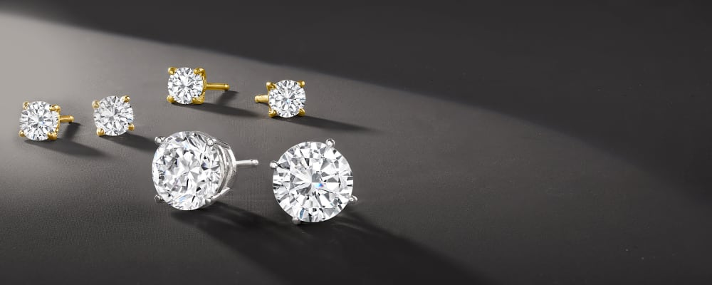 CZ Earrings. Luxe Looks For Less. Image Featuring CZ Earrings on Dark Background