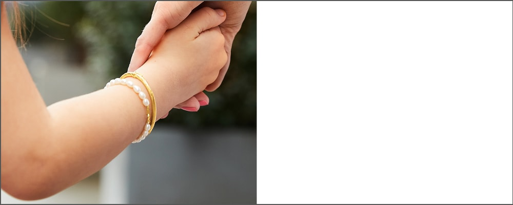 Children's Jewelry. Charming Picks For Little Ones. Image featuring Mother and Child Holding Hands and Wearing Jewelry