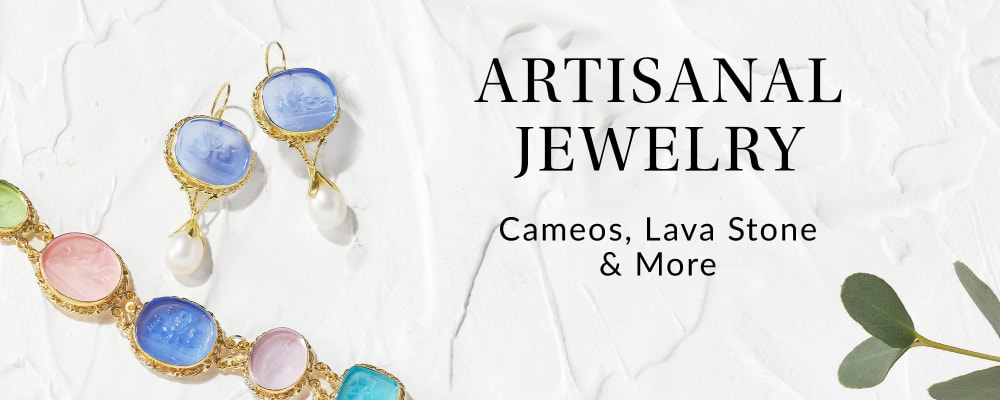 Artisinal Jewelry. Cameos, Lava Stone & More. Image Featuring Gemstone Jewelry on White Stucco Background