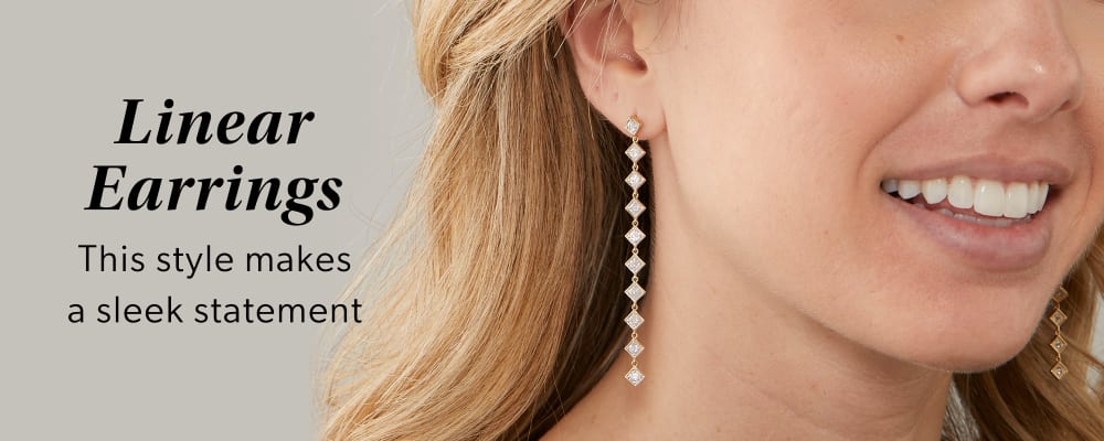 Linear Earrings -- This style makes a sleek statement. Model wearing linear earrings.