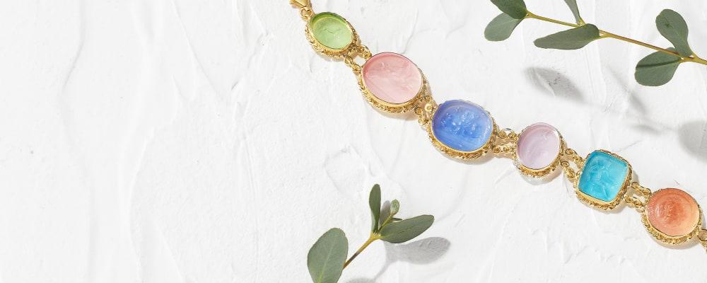 Italian Bracelets. Top-Notch Designs. Image Featuring Glass Bead Bracelet on White Stucco Background