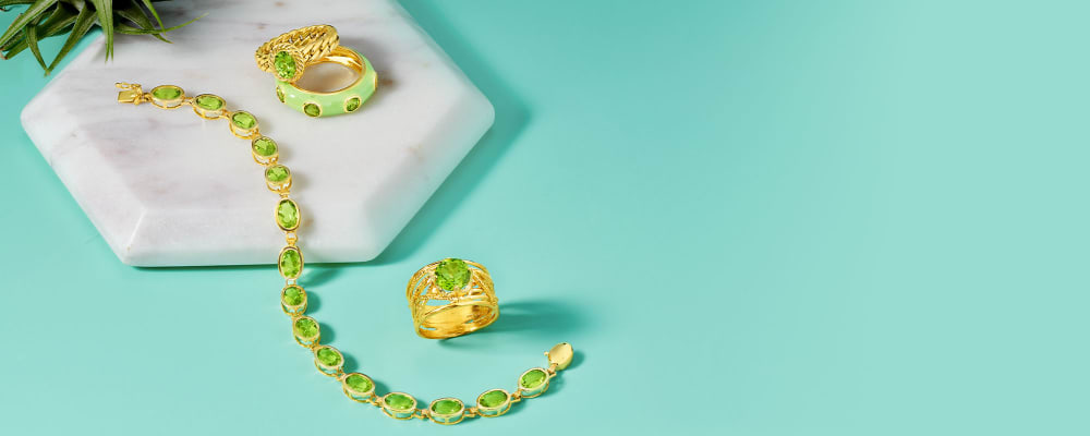 Peridots, Vibrant and nature-inspired. Image Featuring an assortment of peridot jewelry