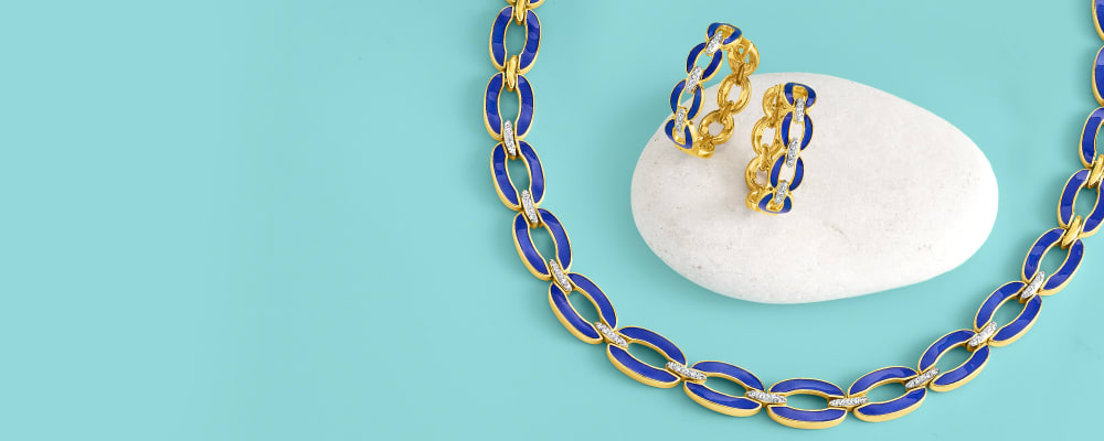 Colorful Enamel. Stand Out In Bold Designs. Image Featuring Enamel Jewelry on Blue Background