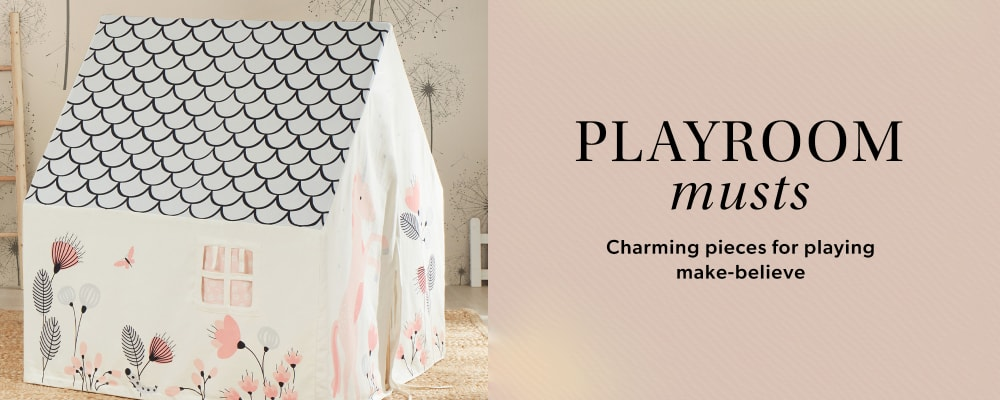 Playroom Musts. Charming Pieces For Playing Make-believe. Image Featuring A Tree Playhouse in a living room setting