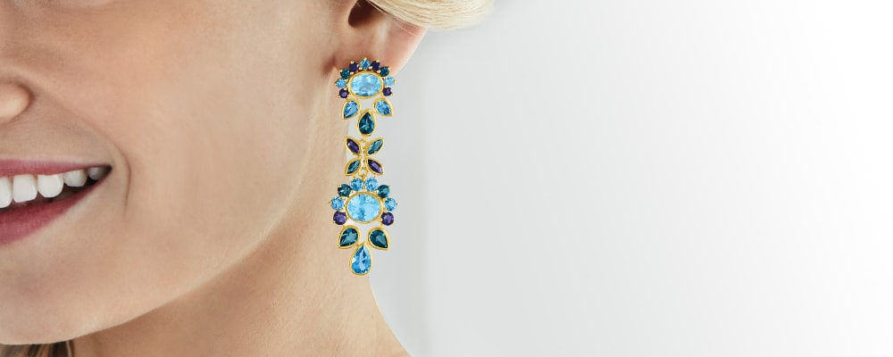 Gemstone earrings vibrant color from ear to ear. Image Featuring Emerald Drop Earrings in Sterling Silver 559226, Ruby Drop Earrings in Sterling Silver 777861, Sapphire Drop Earrings in Sterling Silver 777864