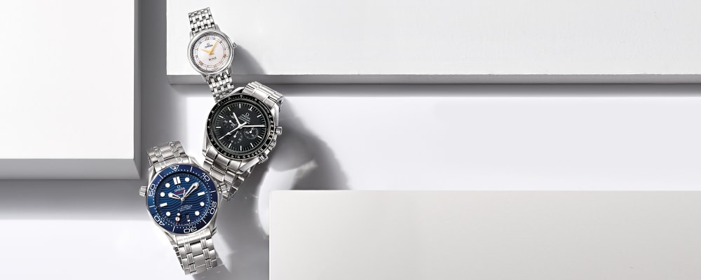 Watches - Timepieces You'll Wear For Ages. Image features Omega De Ville Prestige Women's 27.4mm Mother-Of-Pearl Watch DVLS16, Omega Speedmaster Moonwatch Men's 42mm Stainless Steel Watch SPDS17, Omega Seamaster Men's 41.5mm Stainless Steel Watch with Blue Dial SMTS1A. Click to shop.