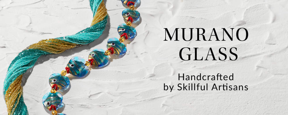 Murano Glass. Handcrafted By Skillful Artisans. Image Featuring Two Murano Necklaces on White Stucco Background