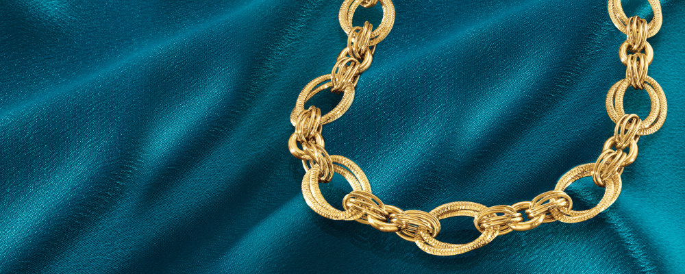 Gold Necklaces. Indulge In Gleaming Designs, Image Featuring Gold Necklace on Deep Blue Background