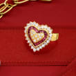 C. 1980 Vintage .75 ct. t.w. Diamond and .50 ct. t.w. Ruby Heart-Shaped Ring in 18kt Yellow Gold