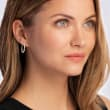 .50 ct. t.w. Baguette and Round Diamond Hoop Earrings in 14kt Rose Gold