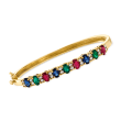 C. 1980 Vintage 4.05 ct. t.w. Multi-Gem and .80 ct. t.w. Diamond Bangle Bracelet in 14kt Yellow Gold