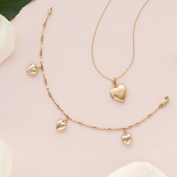 The Little Charmers. Pretty picks for the flower girl. Image of children's heart necklace and bracelet.