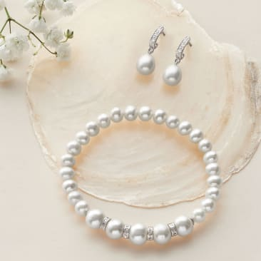 Blissful Bridemaids. Styles she'll be happy to wear again. Pearl earrings and bracelet pictured.