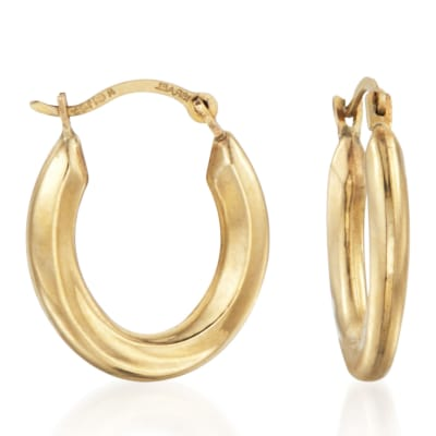 Gifts Under $100. Image Featuring Gold Hoop Earrings