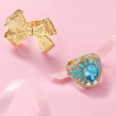 Gold filigree bow jewelry and a blue cocktail ring
