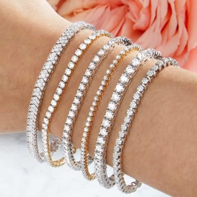 Woman's wrist with stack of tennis bracelets
