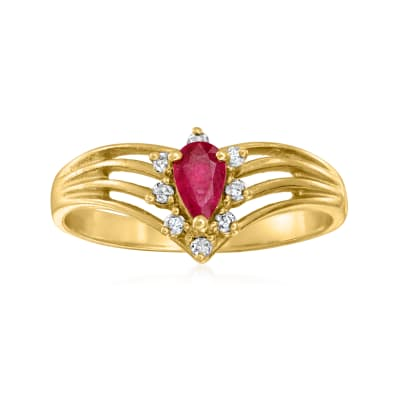 C. 1980 Vintage .25 Carat Ruby Ring with .10 ct. t.w. Diamonds in 14kt Yellow Gold
