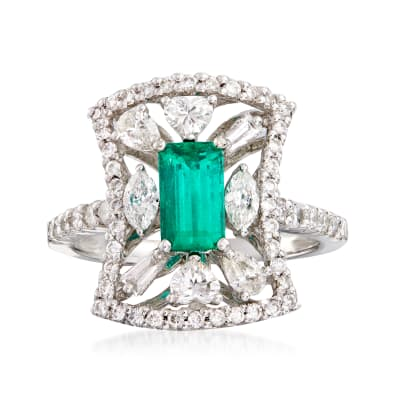 C. 1980 Vintage .85 Carat Emerald and 1.23 ct. t.w. Diamond Ring in Platinum