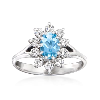 C. 1980 Vintage .58 Carat Aquamarine and .50 ct. t.w. Diamond Halo Ring in 14kt White Gold