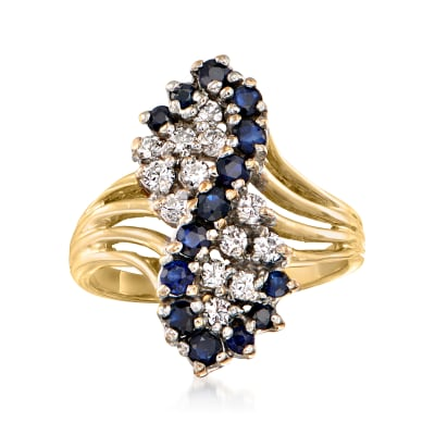 C. 1980 Vintage 1.00 ct. t.w. Sapphire and .35 ct. t.w. Diamond Cluster Ring in 14kt Yellow Gold